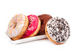 Four donuts and saucer isolated - 72999334