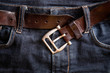 undone belt buckle on blue jeans