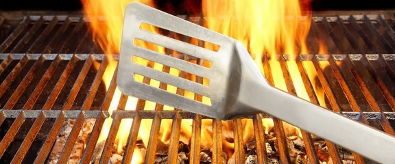 Spatula on Flamibg BBQ Grill