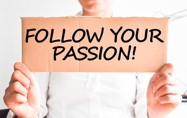 Follow your passion text hold by businesswoman