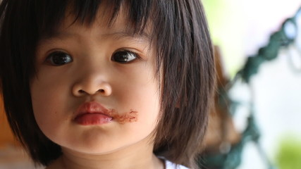 Baby eating chocolate