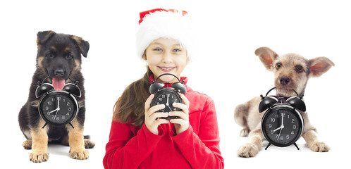 child in Santa hat holding alarm clock