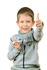 laughing boy holding a thermometer and shows thumb isolated on w