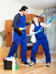 Playful cleaning premises team in uniform