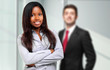 Multiethnic couple of smiling business people