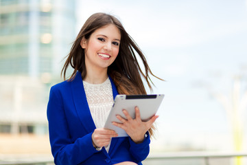 Smiling businesswoman using her tablet