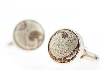 Cufflinks on white background