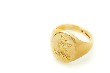 Family gold old seal ring isolated on white background