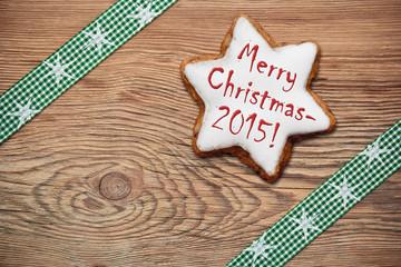 Zimtstern auf Holzhintergrund - Merry Cristmas!