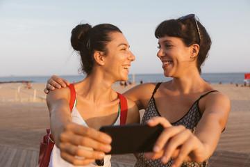 Beautiful Young Women Taking Selfie in Coney Island
