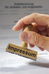 Impressum marked on rubber stamp