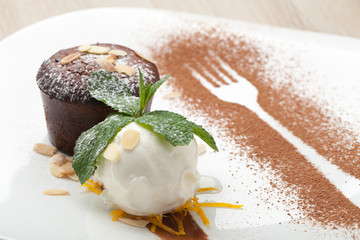 Warm chocolate cake Fondant with ice-cream ball, almond, mint, c