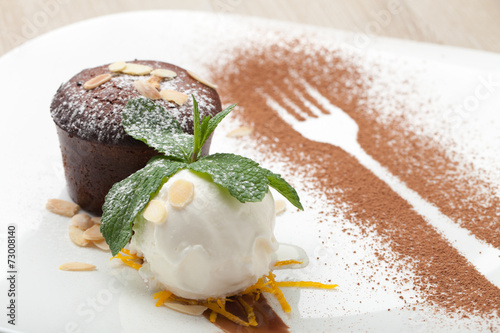 canvas print picture Warm chocolate cake Fondant with ice-cream ball, almond, mint, c