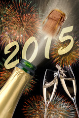 happy new year 2015 with firework and popping champagne