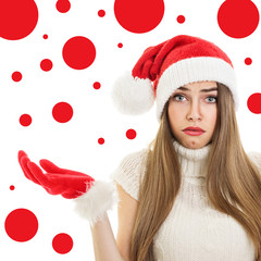 Confused teenage girl with Christmas hat and gloves