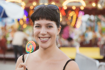 Happy Young Woman eating Lollipop