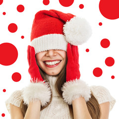 Young woman with Christmas hat and gloves smiling
