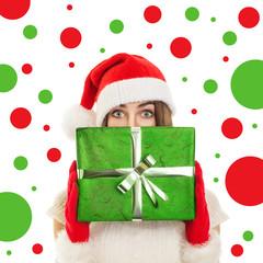 Green eyed Santa girl holding big green giftbox