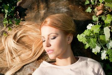 Girl sunbathe  in a autumn park