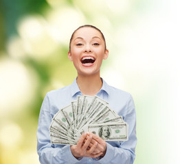 laughing businesswoman with dollar cash money