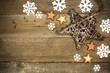 Wood Christmas background with star and snowflake corner border