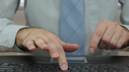 Businessman Slamming Laptop Keyboard