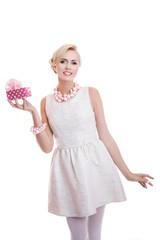 Happy beautiful woman holding small gift box with ribbon