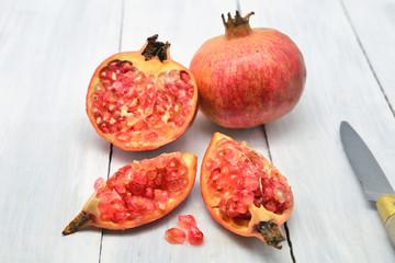 Delicious fresh fruit, ripe juicy pomegranates isolated on white