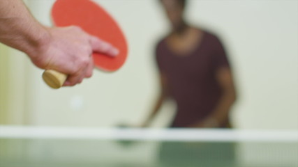 Slow motion close up of a man serving in table tennis