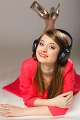Technology, music - smiling teen girl in headphones