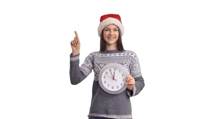 happy beautiful girl  in hat of Santa Claus with clock