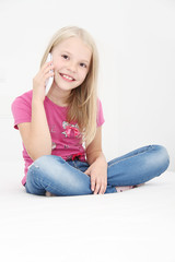 Little girl talking on mobile phone