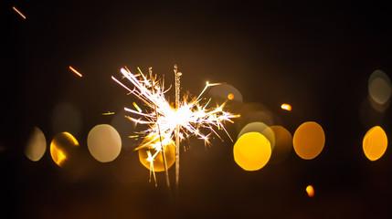 Sparkler and colorful bokeh christmas