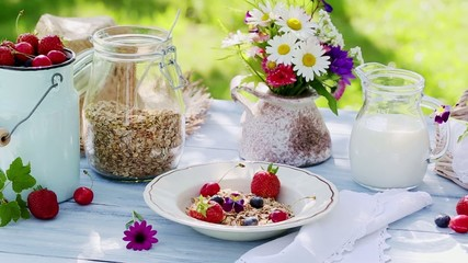 Breakfast with fresh fruits in summer garden
