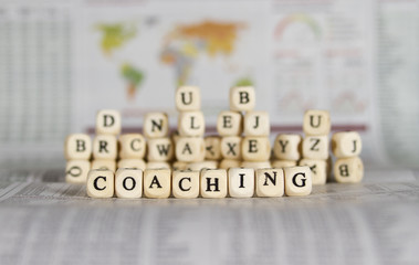 coaching word on newspaper background