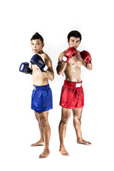 two asian men exercising thai boxing