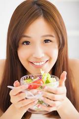 beautiful girl eating healthy food salad