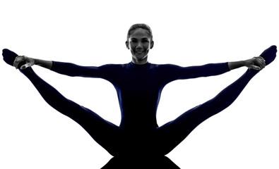 woman exercising stretching splits yoga silhouette