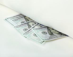 Hidden money under pillow close up