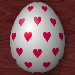 White decorated Easter egg with hearts on wooden texture