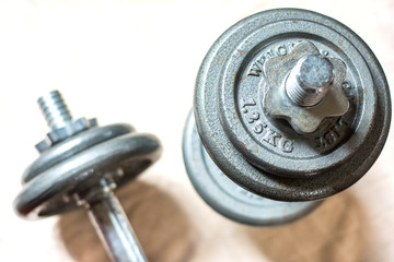 fitness dumbbells in gymnasium