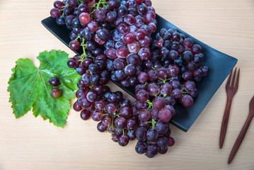 Grapes on a wooden tray