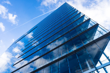 blue glass wall of skyscraper.  Buildings abstract