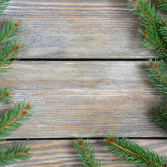 Christmas frame with pine branch on wooden boards