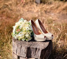 Wedding bouquet from beige high heel shoes. nature