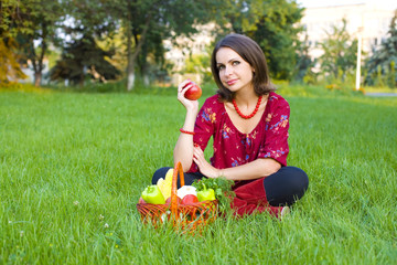horizontal portrait of the beautiful woman with apple in hand