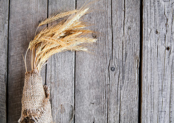 Sheaf on beige plate and wooden background