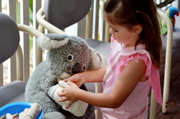 Little girl play pretend to be animal doctor - Veterinary physic
