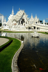 Thailand White Temple Chiang Rai Province and reflection on wate