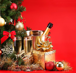 Christmas or New Year's Eve. Champagne and Presents over Red